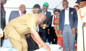 Rivers State Governor, Chief Nyesom Ezenwo Wike (left), performing the foundation laying of NLNG head quarters building in Port Harcourt, yesterday.