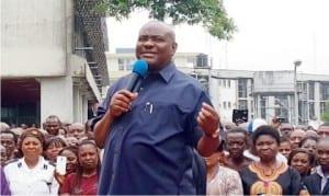 Governor Nyesom Wike (right),  addressing civil servants in Port Harcourt