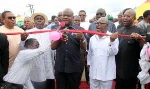 Governor Nyesom Wike of Rivers State (middle), Senator George Sekibo (2nd left), Hon Chisom Promise Dike (left), Sole Administrator of Grater Port Harcourt, Ambassador Desmond Akawor (right) and CTC Chairman of Oyigbo LGA, Hon. Nnamdi Ihute (2nd right), during the commissioning of Oyigbo Market Road in Oyigbo recently.