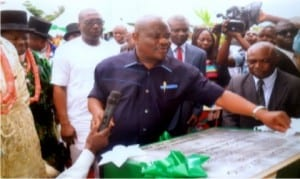 Rivers State Governor,Chief Nyesom Wike, unvailing a plague at the commissioning of 50 medium income housing units at Iriebe in Port Harcourt last Friday.                                       Photo: Ibioye Diama