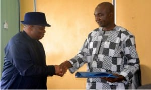 Permanent Secretary, Ministry of Information and COmmunications, Mr Sam Woka (right), in a hand shake with Vice President, ECOWAS Community Court of Justice, Hon Justice Chijioke Friday, during a courtesy call to the ministry in Port Harcourt yesterday.                    Photo: Ibioye Diama
