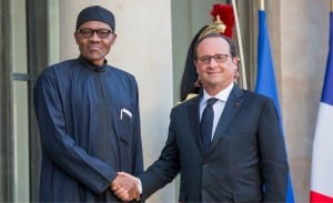 President Muhammadu Buhari (left), being welcomed by President Francoise Hollande of Franc at the Elysee Palace in Paris recently.