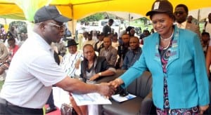 Rivers State Chairman, Nigeria Union of Teachers, Comrade Nkpogone Dumnaatah Lucky (left), welcoming Rivers State Deputy Governor, Dr. (Mrs) Ipalibo Harry-Banigo, to the 2015 World Teachers Day celebration at Isaac Boro Park, Port Harcourt on Monday