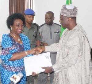 Outgoing Head of the Civil Service of the Federation, Mr Danladi Kifasi (right), handing over to his successor, Mrs Winifred Eyo-Ita in Abuja, yesterday.