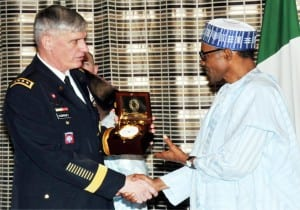President Muhammadu Buhari (right), receiving a souvenir from the visiting Commander of the  US African Command, Gen. David Rodriguez  in Abuja on Wednesday