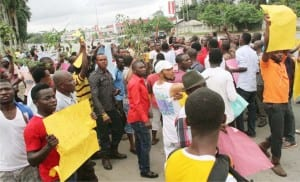 Supporters of the liberation of 'Biafra' protesting the arrest of Director of Radio Biafra, Mazi Nnamdi Kalu in Port Harcourt, yesterday.