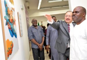 'Ambassador of Mexico to Nigeria, Mr Marco Blanco (2nd right), pointing at an artwork exhibited, during the Universal Declaration of Human Rights in Local Languages celebration  in Abuja on Tuesday. With him are the Executive Secretary, National Human Rights Commission, Prof.Ben Augo ( 2nd left) and Director-General, National Orientation Agency, Mr Mike Omeri (right).