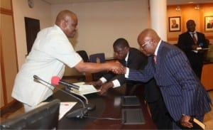 Rivers State Governor,  Chief Nyesom Ezenwo Wike (left), congratulating  Barrister Harvey Ideozu, after being sworn-in as Special Adviser to the Governor in Government House, Port Harcourt, recently.