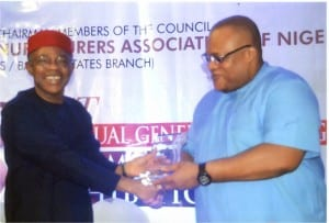 Secretary to Rivers State Government, Chief Kenneth Kobani (right), receiving an award of excellence  from the President, Manufacturers Association of Nigeria, Dr Frank Jacobs, during the association's Annual General Meeting/First Made in Nigeria Exhibition in Port Harcourt, recently.                           Photo: Egberi  A. Sampson