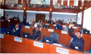 Rivers State lawmakers voting to pass the N104.2 billion Supplementary Budget in Port Harcourt, yesterday.