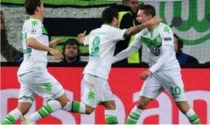 Wolfsburg players celebrating their victory over Manchester United after their elimination from the Champions League