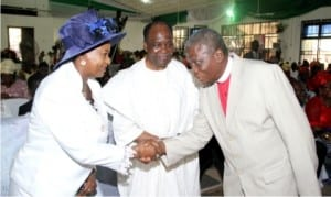 Rivers State Deputy Governor, Dr (Mrs)  Ipalibo Harry Banigo, in a handshake with the General Superintendent of Glorious Covenant Church, Pastor Samuel Akinola (right), during the Nigeria Prays' South-South Zone's prayer meeting in Port Harcourt on Sunday. With them is  former Head of State, Gen. Yakubu Gowon (rtd).