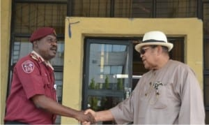 Chairman, Rivers State Council of Traditional Rulers, King Dandeson Douglas Jaja (right), welcoming the Commander, Federal Road Safety Corps, Mr Andrew Ayodele, during a courtesy visit to the state, yesterday.  Photo: Ibioye Diama