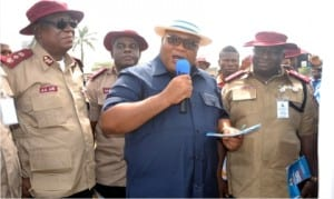 Secretary to Rivers State Government, Chief Kenneth Kobani (middle), addressing participants, during the ,Mega Rally organised by FRSC in Port Harcourt, yesterday. With him are A.A Abu (left) and Bisi Kazeem (right)