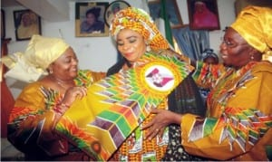 Nigerian Ambassador to Gambia, Amb. Esther Ausu (left) and President, FCT Indigenous Women Forum, Mrs Rifkatu Chidawa (right), decorating the President, National Council of Womewn Society (NCWS), Mrs Nkechi Mba, during a countesy visit by the members of the forum to NCWC Presidnet in Abuja on Wednesday.