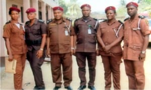 Rivers State Commander, Vigilante Group of Nigeria, Pastor Humphrey Opuada Gally (3rd left), with his Deputy, Comrade Chukwuka Osumah (3rd right), A/C Finance, Rivers State, Mrs Chizoba Chukwu (left), Commander, Obio/Akpor Local Governemnt Area, Ifunaya Owezim (2nd left), Commander, Abua/Odual LGA, Joy Davies and Commander, Okrika Local Government, Ibinabo R. Adoki, during the decoration of officers at the command's secretariat in Oyigbo, yesterday.