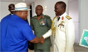 Secretary to Rivers State Government, Chief Kenneth Kobani (left), in a handshake with Naval Commander S. K. Ibrahim (right), during the 2016 Armed Forces and Remembrance Day celebration in Port Harcourt, yesterday.With them is the 2 Brigade Commander, Port Harcourt, Bregadier S. O. Olabanji            Photo: Nwiueh Donatus Ken
