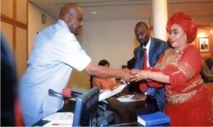 Rivers State Governor, Chief Nyesom Wike (left) congratulating Mrs Tonye Oniyide, during her swearing-in as Commissioner at Government House in Port Harcourt on Friday.                                                                                                                                                           Photo: Chris Monyanaga
