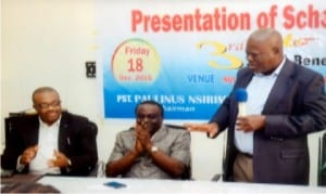 Prince Emma Anyanwu (right), addressing guests, during the Prince Emma Anyanwu Foundation for Journalist in Rivers State Scholarship Award at NUJ Press Centre , Moscow Road, Port Harcourt on Friday. With him, are Director of Enlightment, Ministry of Information and Communciations, Pastor Paulinus Nsirim (middle) and General Manager, RSNC, Mr Celestine Ogolo