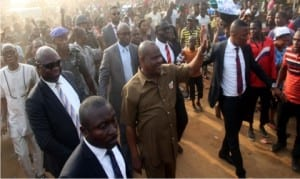 Governor Nyesom Wike of Rivers State (middle), acknowledging cheers from a jubilant crowd that trooped out to welcome him at Bishop Okoye Street in Mile 3 Diobu, Port Harcourt, during an inspection of road projects in the area on Monday