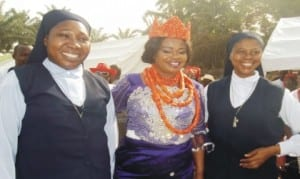 L-R: Sister Charlesmaria Emechebe  of  Holy Family Sisters of the Needy,  Okwu Uratta,  Imo State Comptroller of Nigeria Immigration Services, Mrs Racheal Uchendu and Sister Innocentia Emenogu of Holy Family Sisters of the Needy, after the  Comptroller was bestowed with a chieftaincy title by Eze David Osuagwu of Awaka in Owerri,  on Sunday.