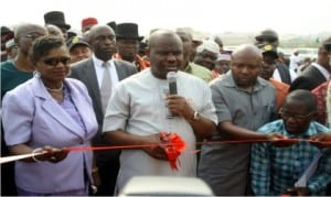 Rivers State Governor, Chief Nyesom Wike (middle), commissioning the Abuloma/Woji Road project in Port Harcourt on Thursday. With him are his deputy, Dr (Mrs) Ipalibo Harry Banigo (left) and Speaker, Rivers State House of Assembly, Rt Hon. Adams Dabotorudima (2nd right)