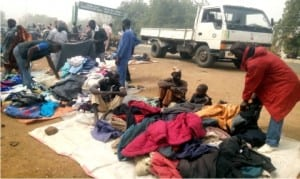 People purchasing fairly used warm clothings against Harmattan at Alocakl Market in Dutse, Jigawa State, recently