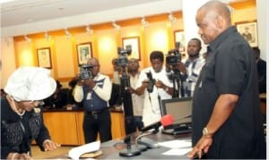 Rivers State Governor, Chief Nyesom Wike (right), swearing-in the  state Chief Judge, Justice Daisy Wotube Okocha at the Executive Council Chamber of Government House, Port Harcourt on Monday.
