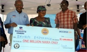 Chief Marketing Officer, Dangote Group, Mr Oare Ojeikere (left), beneficiary, Mrs Ebiokpo Endurance (middle) and South-South Zonal Cordinator, Prince Chinonye Ikegwuraka with the cheque,during a mega million promo in Port Harcourt, recently.                                                                                             Photo: Nwiveh Donatus Ken