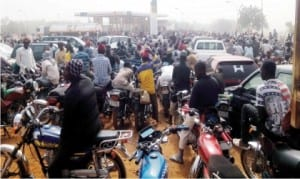 A crowd of people waiting to purchase petrol at the NNPC Mega Station in Dutse, Jigawa State, as fuel scarcity intensifies recently.
