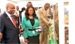 L-R: Vice-Chancellor of Covenant University, Prof. Charles Ayo, who represented Bishop David Oyedepo, Vice-Chancellor of Landmark University, Prof. Aize Obayan and Deputy Vice-Chancellor of Landmark University, Prof. Enoch Oyawoye, inaugurating an exhibition, during the 6th matriculation ceremony of the university in Omu-Aran, Kwara State on Friday