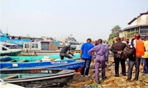 Electoral materials for Bayelsa State governorship Supplementary election being loaded into boats at the Naval Marine Dock in Yenagoa on Friday
