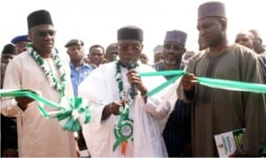 L-R: Governor  Abdulfatah Ahmed of  Kwara State, Minister  of  Agriculture and Rural Development, Chief  Audu Ogbe and Vice President, Dangote Group, Alhaji Sani Dangote, at the inauguration of  the second phase of  Agricultural  Equipment Hiring Enterprise at the National Centre for Agricultural Mechanisation in Ilorin, yesterday