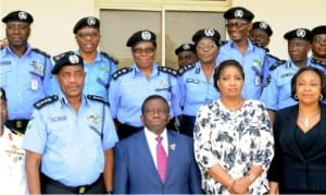 L-R: Front row: I-G Solomon Arase, Minister of Health, Prof. Isaac Adewole, President, Police Officers Wives Association (Powa), Mrs Aragesa Arase, Director of Health Planning, Research and Statistics, Federal Ministry of Health, Dr Ngozi Azodo and other officials at the stakeholders revalidation meeting on Nigeria Police Force's Health Policy, in Abuja, yesterday