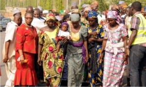 Mmembers of the Bring Back Our  Girls leading the parents and relations of the  abducted Chibok girls to Presidential Villa in Abuja, during a protest march, yesterday.