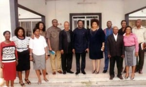 Rivers State Commissioner for Information and Communications, Dr Austin Tam-George (middle), in a group photograph with members and staff of Treasure FM in Port Harcourt, on Wednesday.