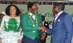 The outgoing President of Nigeria Society of Engineers (NSE), Mr Isaac Olorunfemi (right), congratulating the incoming President, Mr Otis Anyaeji (middle), during his investiture as the 30th President of the body in Abuja, recently. With them is the wife of the incoming President, Mrs Nkechi Anyaeji