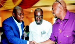 Former Deputy Speaker, House of Representatives, Rt Hon Austin Opara (left), in a handshake with the state Commissioner for Sport, Hon Boma Iyaye (right) and President of Go Round FC, Felix Obuah, during the unveiling ceremony  of the Mascot for Secondary School Athletics Championship in Port Harcourt, yesterday.