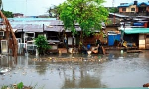 Flood as a result of the first rainfall at Iyana Oworo in Lagos last Tuesday