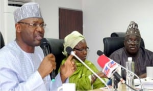 L-R: Chairman, Independent National Electoral Commission (INEC), Prof. Mahmood Yakubu, National Commissioners, Mrs Amina Zakari and Mr Adedeji Soyebi, at the meeting with Civil Society Organisations in Abuja on Thursday