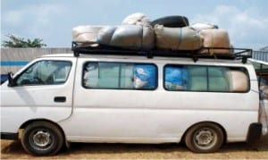 A overloaded bus with smuggled second hand clothings impounded by Nigerian Customs Service in Owerri on Monday .