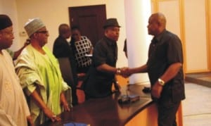 Rivers State Governor, Chief, Nyesom Ezenwo Wike (right),   in a handshake with Acting National Chairman of PDP, Prince Uche Secondus (middle), during a congratulatory  visit to Governor Wike at the Government House, Port Harcourt, yesterday. With them is Secretary of the Board of Trustees of PDP, Senator Jubril Wahlid (2nd left)