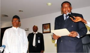 Chairman, Army-Shitee Clash Judicial Commission of Inquiry, Justice Mohammed Garba (right), taking oath of office before Governor Nasir El-Rufai of Kaduna State, during the inauguration of the judicial commission of inquiry in Kaduna on Friday.