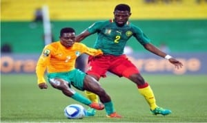 An Ivorian player (2) dancing beyond a Cameroonian defender in the CHAN quarter final match on Saturday