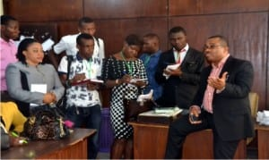 The General Manager, Rivers State Newspaper Corporation, Mr Celestine Ogolo (right), addressing students of the International Institute of Journalism, during a capacity building tour of the corporation in Port Harcourt on Monday             Photo: Ibioye Diama