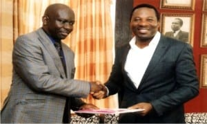 Rivers State Commissioner for Information and Communications, Dr Austin Tam-George (right), receiving a document from President, (Nigeria Institute of Public Relations (NIPR), Dr Rotimi Oladele, during a courtesy visit to the commissioner in Port Harcourt, yesterday