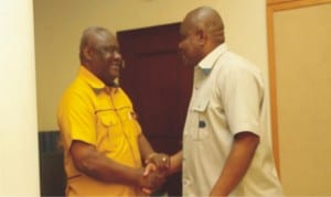 Rivers State Governor, Chief Nyesom  Wike (left), welcoming INEC's Rivers State Resident Electoral  Commissioner, Elder Ikiowak Aniedi to Governemt House, Port Harcourt, during a courtesy visit  on  Friday