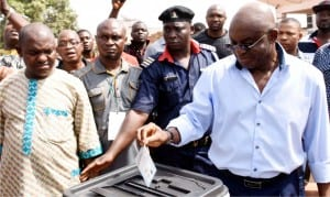 Peoples Democratic Party's candidate and former Senate President, David Mark, casting his vote at Otukpo,  Ward 1, during the Benue South Senatorial election re-run in Benue State, on Saturday.