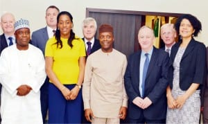 Vice President Yemi Osinbajo (middle), with delegation from the United Kingdom Trade Mission, during its visit to the Presidential Villa in Abuja, recently