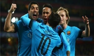 Lionel Messi and his team mates celebrating his first goal yesterday against Arsenal  during the Champions League match. Barca won by 2-0